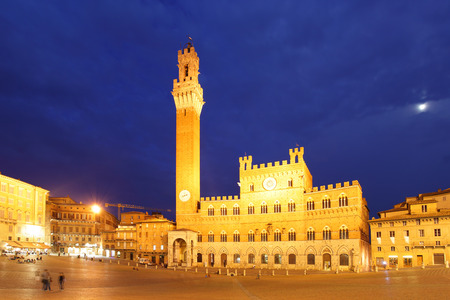 siena italy: Campo Square and Mangia Tower in Siena at night, Italy