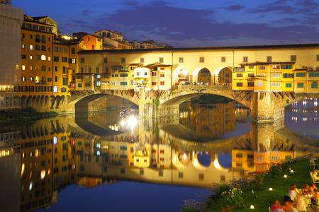 Ponte Vecchio bridge in Florence at night, Italy photo