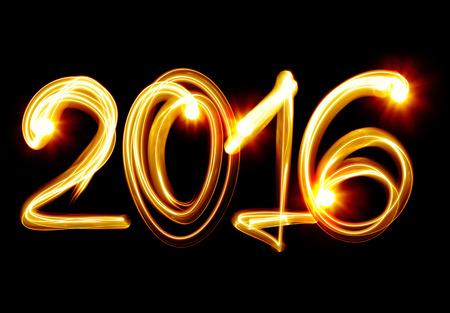 光によって幸せな新しい年 2016 年 写真素材