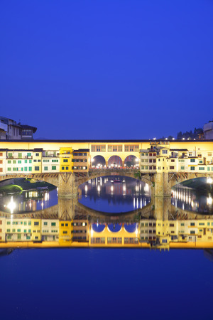 Ponte Vecchio bridge in Florence at night with copyspace, Italy photo