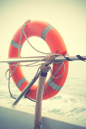 guard ship: Red lifebuoy. Retro style filtred image Stock Photo