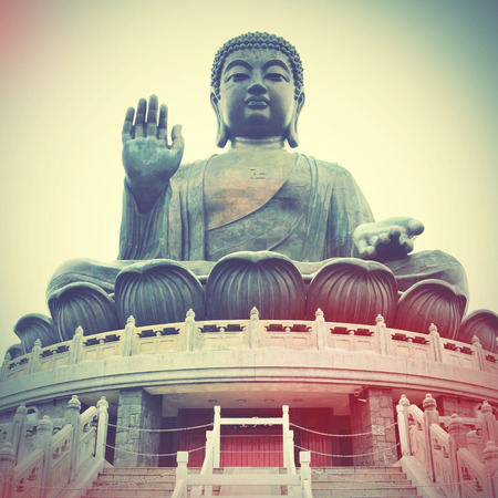 buddha hand: Giant Buddha in Hong Kong. Retro style filtred image Stock Photo