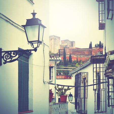 granada: Old narrow street in Granada, Spain. Retro style filtred Stock Photo