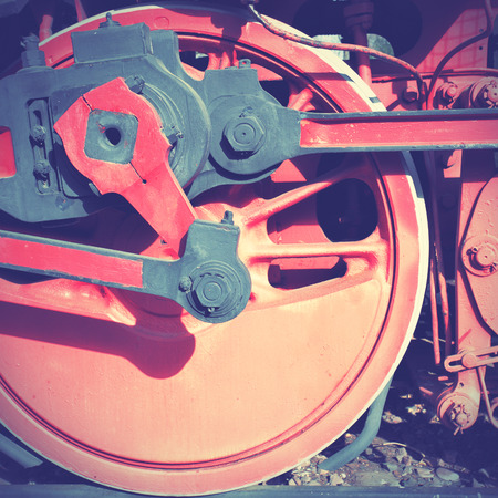 Steam locomotive wheel and rods. Retro style filtred photo