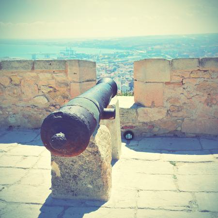 santa barbara: Old cannon in Santa Barbara fortress, Alicante, Spain. Retro style filtred image