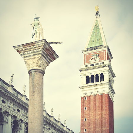 Campanile and statue of St.Theodore on San Marco square, Venice, Italy. Retro style filtred Stock Photo