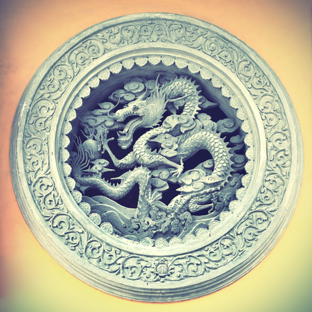 Chinese dragon in old tample, China. Retro style filtred