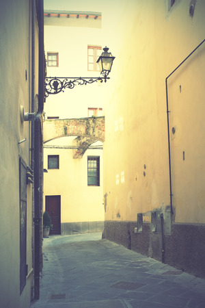 Old side street in Pistoia, Italy. Retro style filtred image photo