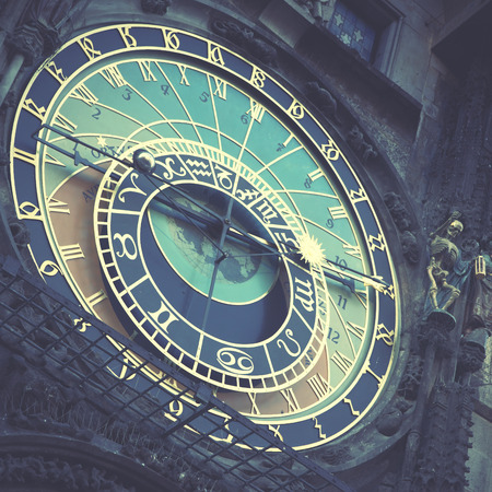 horologe: Old astronomical clock in Prague (The Horologe), Czechia. Retro style filtred image