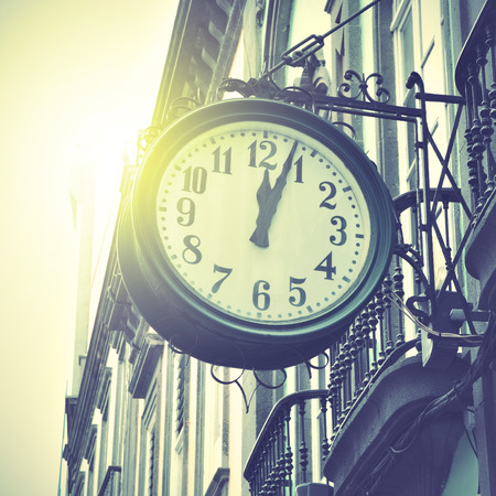 tardiness: Old clock at railway station. Retro style filtred image