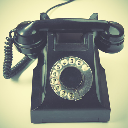 old fashioned rotary phone: Vintage telephone. Retro style filtred image