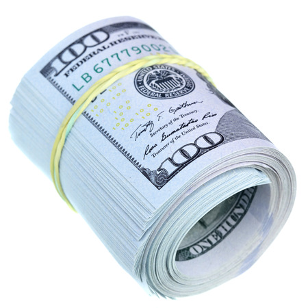 butch: Roll of US dollars isolated over the white background Stock Photo
