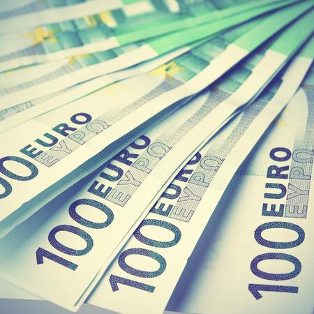 payout: Los billetes en euros de cerca. Estilo retro imagen filtred Foto de archivo