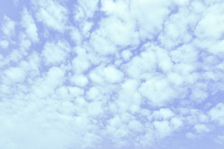 Light blue spring sky with clouds, may be used as background photo