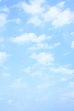 blue light: Light blue spring sky with clouds, may be used as background