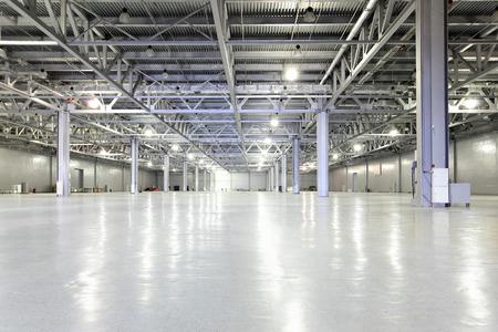Interior of big empty storehouse photo