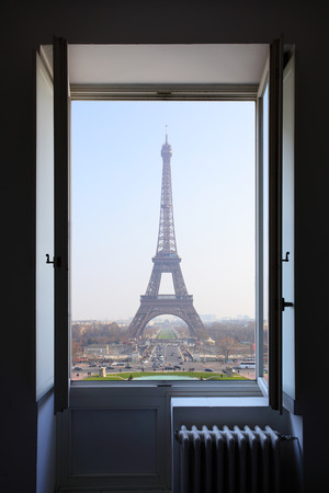 tower house: Open window and Eiffel Tower behind