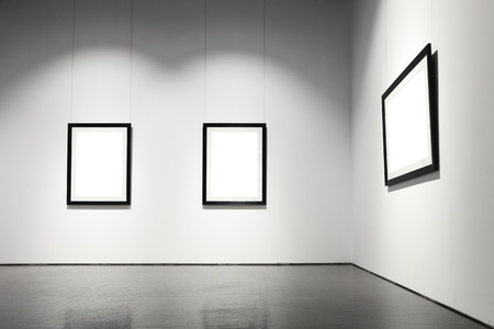 art exhibition: Exhibition hall with empty frames on wall
