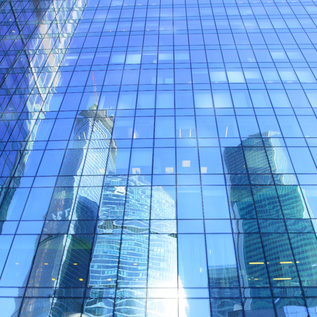 administrative buildings: Reflections of modern office buildings - architectural and business background Stock Photo