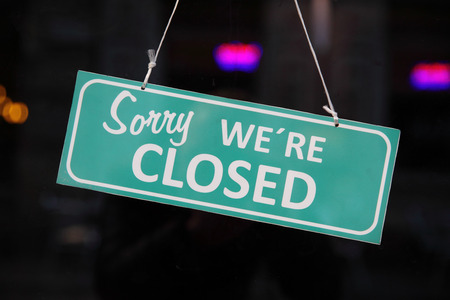 glass door: Closed sign. (Sorry we are closed)