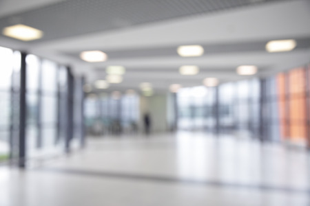 business centre: Corridor in airport out of focus Stock Photo