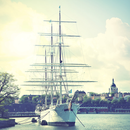 chapman: Historical ship at the Old Town in Stockholm, Sweden. Retro style filtred image