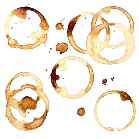 taza cafe: Conjunto de manchas de café aislados en el fondo blanco (usado café de verdad) Foto de archivo