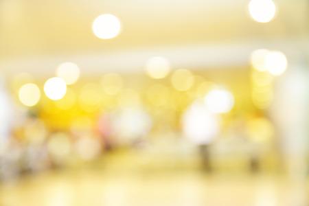 christmas lights background: Colorful lights of shop windows - defocused blured background
