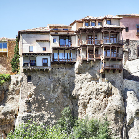 steep cliff: Ancient hanging houses Casas Colgadas in Cuenca, Spain Stock Photo