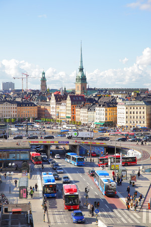 stan: STOCKHOLM, SWEDEN - May 21, 2015: Old Town Gamla Stan in Stockholm and traffic near Slussen subway stantion