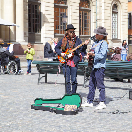 acoustical: STOCKHOLM, SWEDEN - May 21, 2015: Unidentified strolling musicians play guitars on Stortorget square in Stockholm Editorial