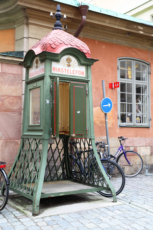 stan: STOCKHOLM, SWEDEN - May 19, 2015: Old Rikstelefon telephone booth in Gamla Stan district in Stockholm Editorial