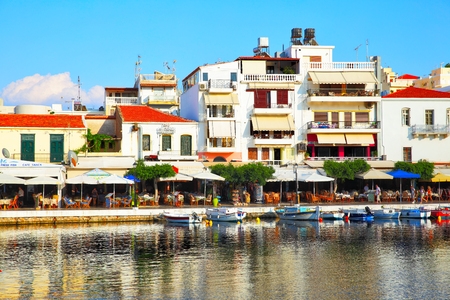 AGIOS NIKOLAOS, GREECE - JUNE 30, 2015: Picturesque waterfront of Voulismeni lake with boats, taverns and restaurantes in Agios Nikolaos, Crete Island Editorial