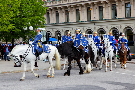 constabulary: STOCKHOLM, SWEDEN - May 20, 2015: Mounted swedish Royal Guards in the dayly procession in Stockholm Editorial