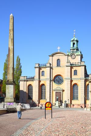 stele: STOCKHOLM, SWEDEN - May 21, 2015: Stele and Cathedral of Saint Nicholas in Stockholm