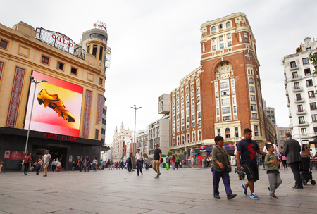 gran via: MADRID, SPAIN - SEPTEMBER 23, 2015: People on Plaza Callao and Gran Via street Spanish Broadway in Madrid Editorial