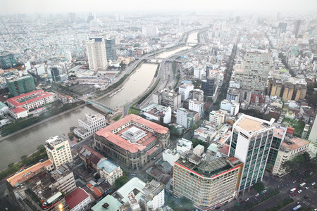 nam: HO CHI MINH CITY, VIETNAM - December 17, 2015: Aerial view of downtown and Kenh Doi river in Ho Chi Minh City Saigon Editorial