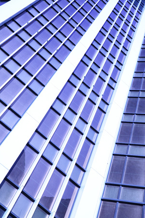 building color: Wall of office building close-up. Toned in blue color