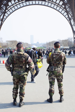 enhanced: PARIS, FRANCE - March 3 ,2011: Enhanced security of military forces under Eiffel tower in Paris