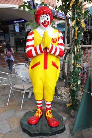 BANGKOK, THAILAND - DECEMBER 12, 2011 : Ronald McDonald in front of a McDonald's restaurant in the city centre in Bangkok