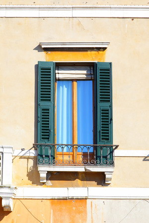 comfortableness: Typical old wndow with shutters in Venice, Italy