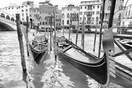 Gondolas on Grand Canal near Realto bridge in Venice, Italy. Black and white