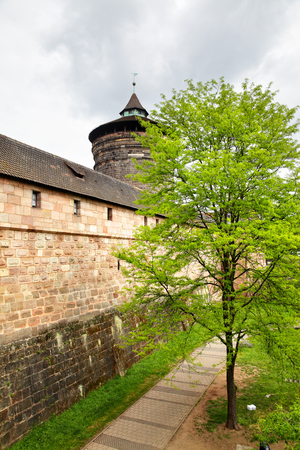 drained: City walls of Nuremberg and park in drained fortification canal, Germany
