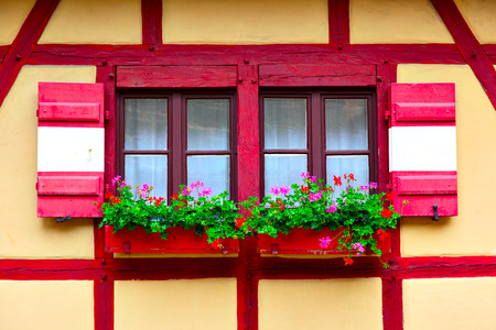 snug: Windows of old house with flowers, Nurnberg, Germany Stock Photo