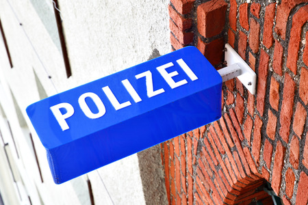 enforce: Police stantion sign in Munich, Germany Stock Photo