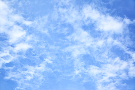 fleecy: Blue sky with light fleecy clouds, may be used as background