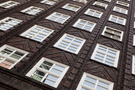 building wall: Windows of old house in Amsterdam, Netherlands Stock Photo