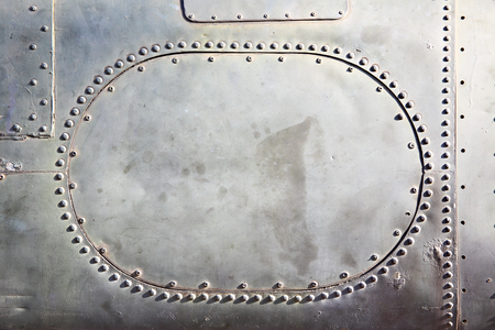 aircraft rivets: Old metal background with plate and rivets