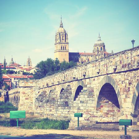 castile leon: Roman bridge and Salamanca Cathedral, Castile and Leon, Spain. Retro style filtered image