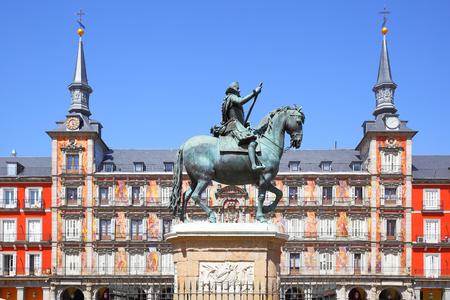 Statue of King Philips III and Casa de la Panaderia (Bakery House) on Plaza Mayor in Madrid, Spain Stock Photo